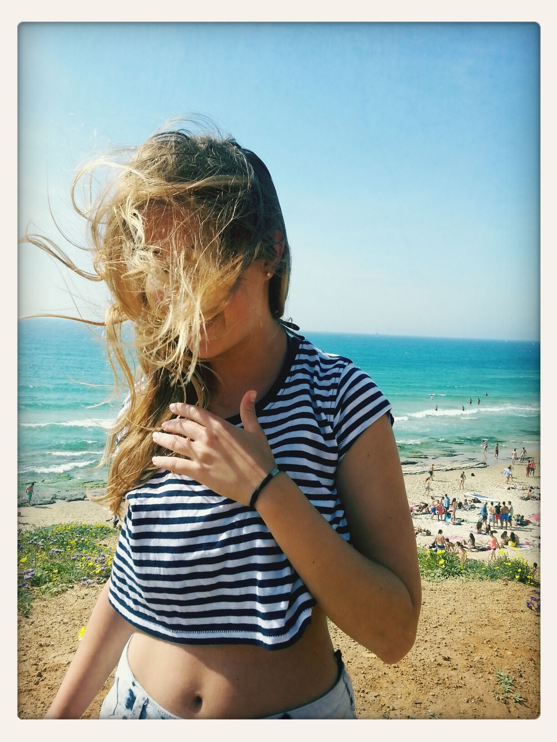 sea, beach, horizon over water, water, leisure activity, lifestyles, person, shore, clear sky, sand, young women, vacations, casual clothing, sunlight, sky, young adult, long hair, childhood