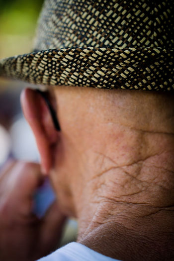 Wrinkled Skin and an Awesome Hat Close-up Cropped Day Detail Focus On Foreground Hat Leisure Activity Lifestyles Outdoors Part Of Person Selective Focus Unrecognizable Person Wrinkled Skin Wrinkles This Is Aging This Is Aging