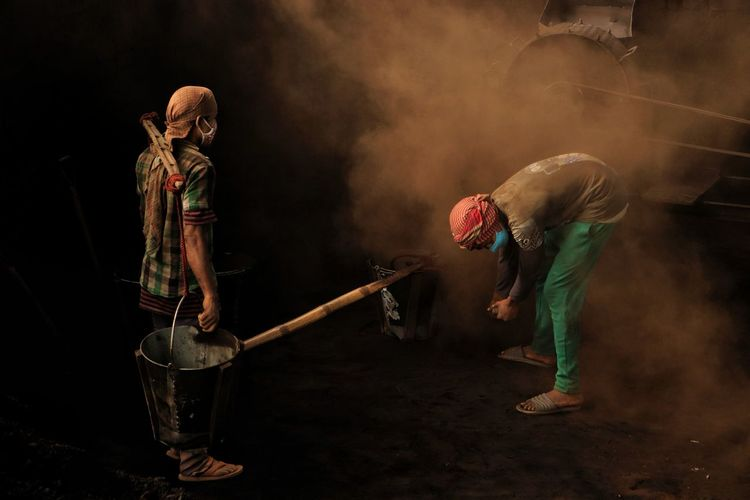 Man working at polluted environment in brick field