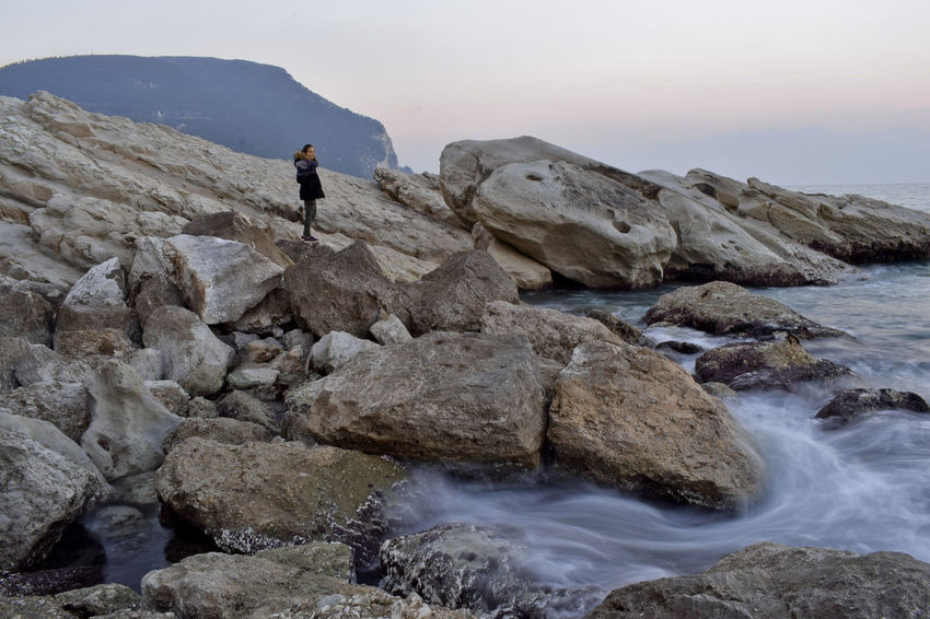 One Person Only Men Full Length Rock - Object Nature Landscape Outdoors Vacations People Beauty In Nature Mountain Day Sea Water Nikon Seascape Sea And Sky Nikon D3300 Beach Rocky Coastline Long Exposure Beauty In Nature Scenics One Man Only Travel