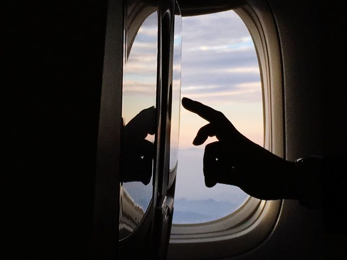 Window Human Hand Transportation Human Body Part One Person Airplane Vehicle Interior Sky Mode Of Transport Real People Holding Indoors  Close-up Day Air Vehicle Airplane Wing People Traveling Home For The Holidays