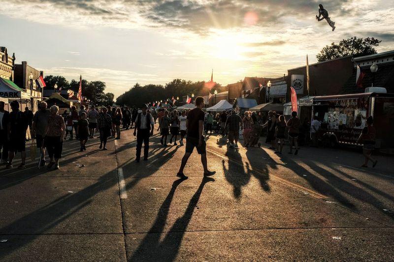 People Celebrating Festival On Road Against Sky