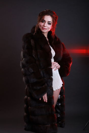 Beautiful Woman Indoors  Clothing Standing Studio Shot Studio Photography Editorial Photography Elégance Warm Clothing Fur Coat Fur Glamour Fashion Model Gray Background Looking At Camera Portrait One Person Front View Winter Young Women Hairstyle Red Three Quarter Length Coat Scarf