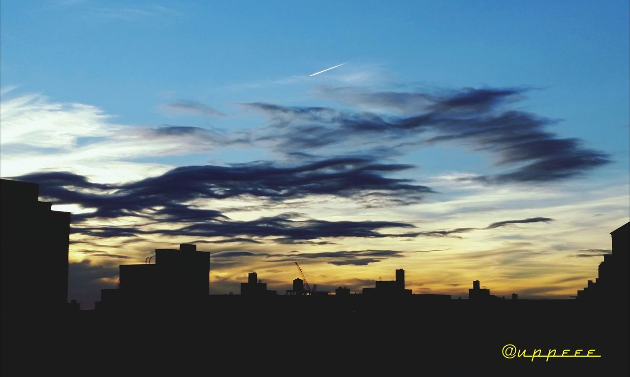 architecture, city, skyscraper, building exterior, sky, built structure, sunset, cityscape, modern, silhouette, cloud - sky, city life, urban skyline, no people, outdoors, travel destinations, day