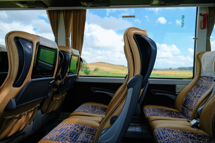 Mode Of Transportation Transportation Car Vehicle Interior Glass - Material Land Vehicle Transparent Motor Vehicle Window Seat Day No People Sky Cloud - Sky Indoors  Vehicle Seat Travel Car Interior Windshield