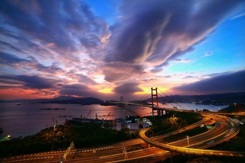 High angle view of tsing ma bridge over sea against sky