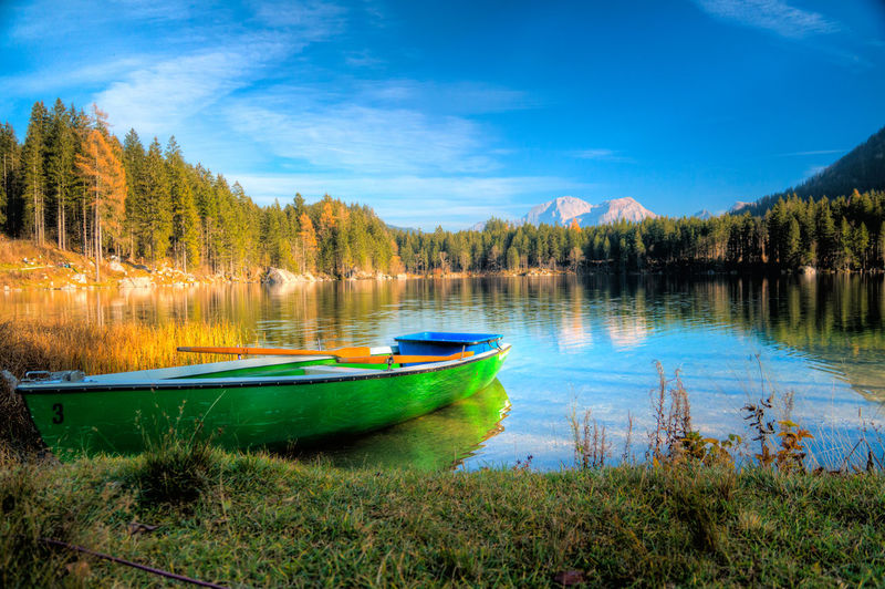 Beauty In Nature Berchtesgaden Blue Boat Calm Cloud Day Germany Grass Hintersee Idyllic Lake Mode Of Transport Nature Nautical Vessel Outdoors Reflection Scenics Sky Tranquil Scene Tranquility Transportation Tree Water Zauberwald