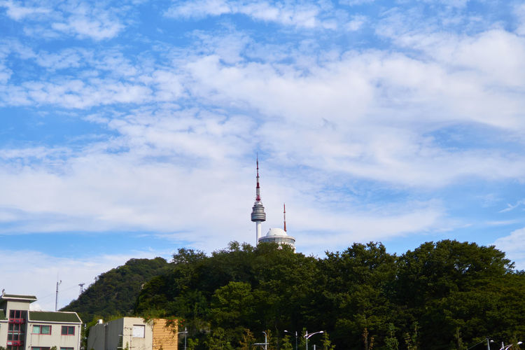 Distant View Of N Seoul Tower Against Cloudy Sky