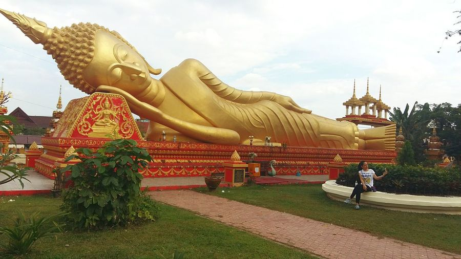Women Outdoors Gold Colored Statue Gold Lifeasiseeit John Nelson Vientiane Johnnelson One Person Asian Woman Buddha Statue Architecture Statuesque Tranquility Temple Buddha  Buddhist