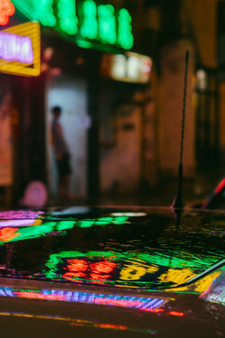 Architecture Arts Culture And Entertainment Built Structure Casino Close-up Focus On Foreground Gambling Illuminated Incidental People Indoors  Leisure Activity Light - Natural Phenomenon Lighting Equipment Multi Colored Night Nightlife Table Text