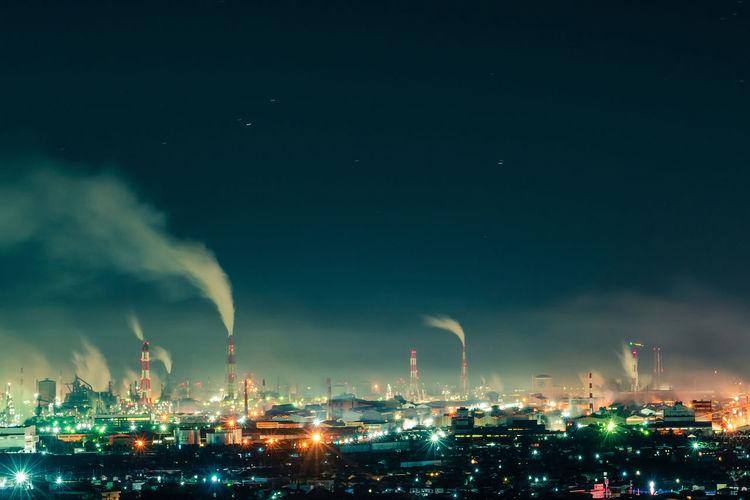 Building Exterior Night Factory Architecture Sky Illuminated Smoke Stack Industry Built Structure Environmental Issues Pollution Fuel And Power Generation Smoke - Physical Structure Cloud - Sky Nature Environment No People Outdoors City Air Pollution Fumes Cityscape Chemical Plant Ecosystem