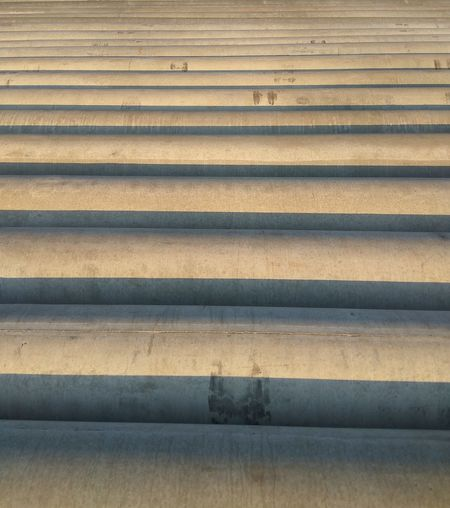 Backgrounds Full Frame Pattern Textured  Day No People Outdoors Parallel Close-up LINE Architecture EyEmNewHere Cylinder Ground Nails Industry Textured  Textured  Straight Construction Safety Architecture Built Structure