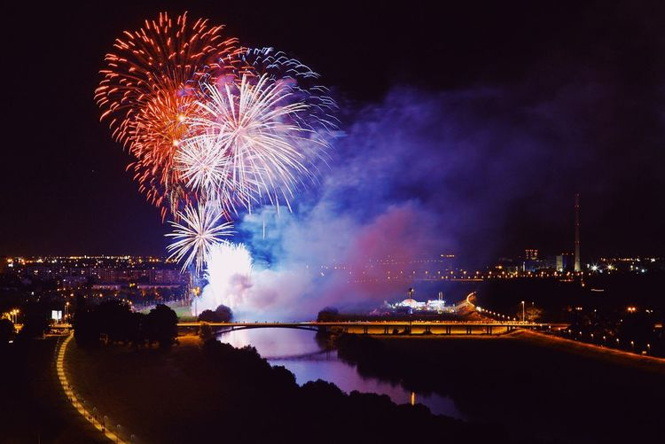 Night Illuminated Firework Celebration Event Firework Display Arts Culture And Entertainment Long Exposure Water Exploding Light Glowing