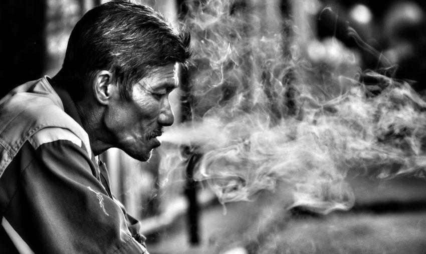 World Emotion Moments Men Oldman Cigarette  Tobacco Smoking Photography Happiness Portrait Headshot Men Males  Side View Forgiveness Concentration Profile View Close-up Cigarette Lighter Tobacco Product Smoking - Activity Cigar Cigarette Butt