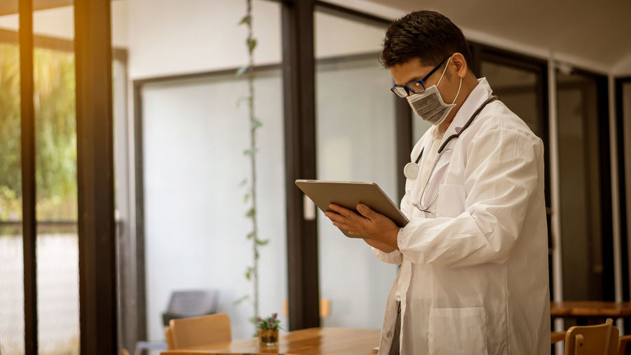 Doctor wearing using tablet at hospital