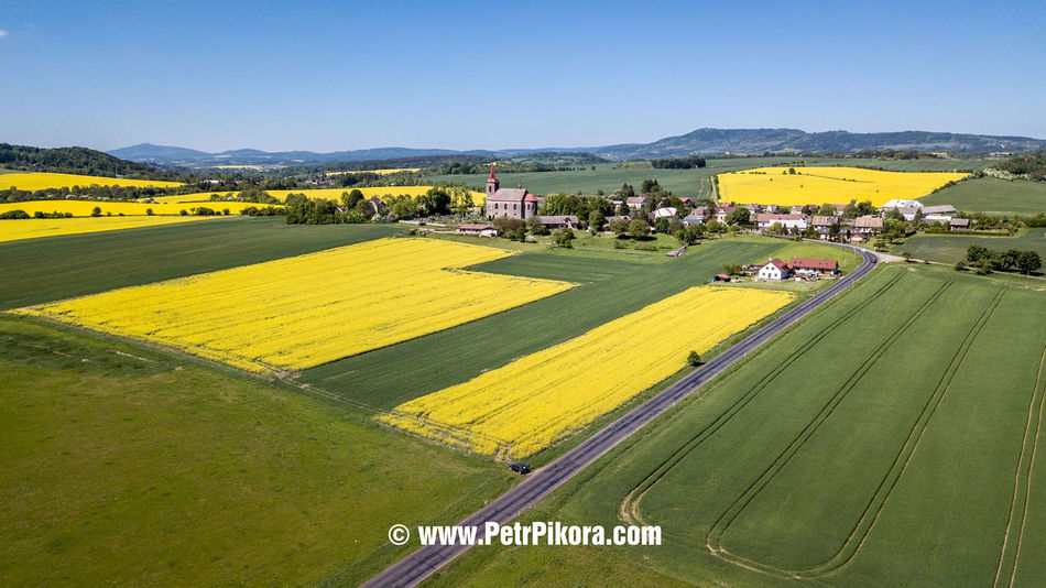 Agriculture Architecture Beauty In Nature Built Structure Day Environment Farm Field Green Color Land Landscape Mountain Nature No People Outdoors Plant Rural Scene Scenics - Nature Sky Tranquil Scene Yellow