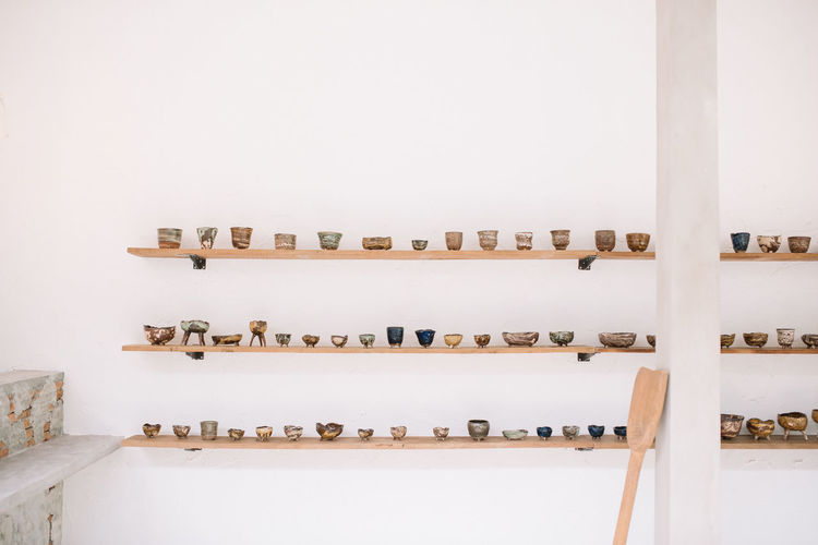 Showcase : Ceramic artwork on wooden shelves ArtWork Ceramic Art Ceramic Cup Ceramic Pot Ceramics Craft Craftmanship Decoration Hobby Home Interior Home Showcase Interior Indoors  Interior Design Lifestyles Shelf Showcasing Wooden Shelves