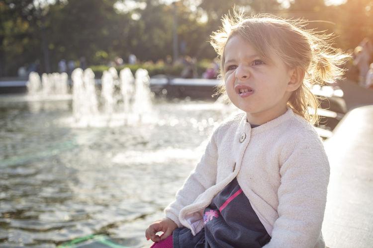 Portrait of cute girl against water
