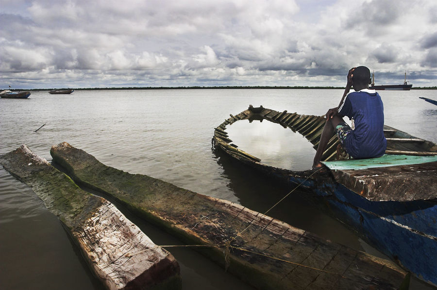 Cayucos of Ziguinchor. Senegal. Beauty In Nature Cayucos Day Hopes And Dreams Horizon Over Water Migration Nature One Person Outdoors People Real People Scenics Water EyEmNewHere EyeEm Best Shots TheWeek On EyEem Lost In The Landscape Connected By Travel