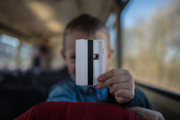 Boy Holding Ticket In Train