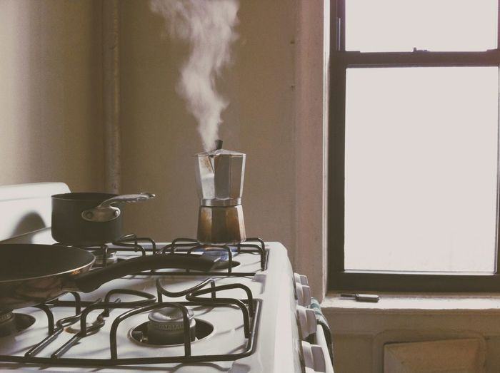 Smoke Coming From Coffee Maker In Kitchen Counter