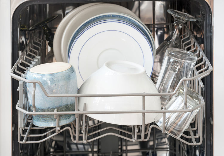 Close-up of kitchen utensils in dishwasher