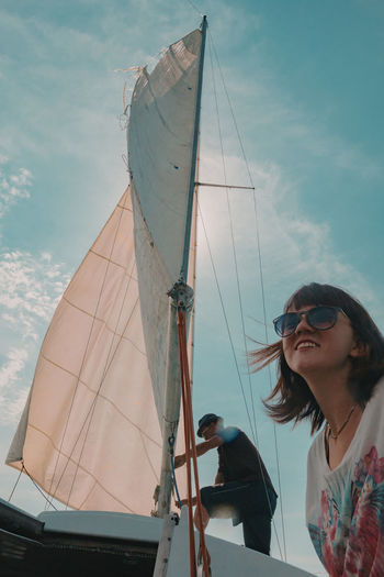 Adventure under sail and the sun. Adults Only Cloud - Sky Day Nature Outdoors People Sailing Sea Sea Adventures Ship Sky Sunlight Tourism Travel Vacations Young Adult Young Women Traveling Home For The Holidays Miles Away