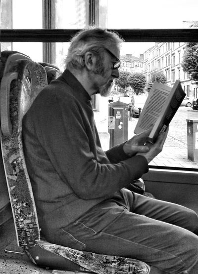 One Person One Man Only Mature Adult Black And White Holding Book Reader Real People Bus Stop, Candid Photography Streets Of Glasgow