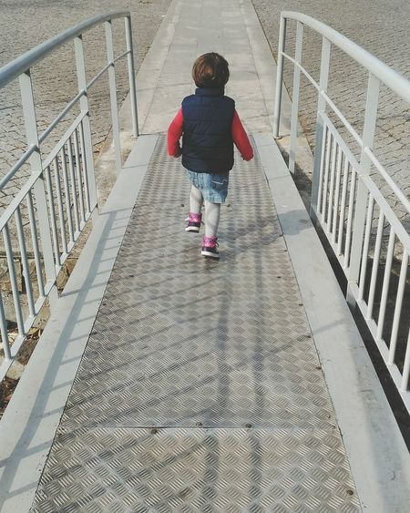 Full Length Girls Childhood One Person Child One Girl Only Rear View People Outdoors Day Children Only Real People City Lifestyles My Baby Girl Running Free Girl Running Baby Girl Running Steel Structure  Steel Construction Bridge - Man Made Structure Bridge