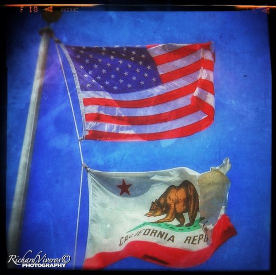 Flag near the Lone Sailor statue at the Golden Gate Bridge San Francisco Ca. CaliLife Golden Gate Bridge California San Francisco