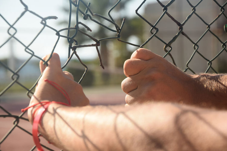 One Person Human Body Part Only Men Close-up Outdoors Men One Man Only Human Hand Block Freedom Escape PeopleHostage Prisoner Prison Wire Jail Behind Chainlink Fence Adult Torn Day Adults Only Chain Catch Inner Power