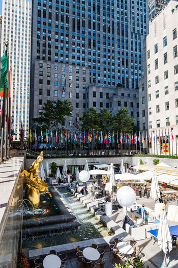 Rockefeller Center Plaza in NYC Manhattan NYC New York New York City Rockefeller Center Rockefeller Plaza Architecture Building Building Exterior Built Structure City City Life Crowd Day Group Of People Incidental People Large Group Of People Men Nature Outdoors Plaza Real People Street Travel Water