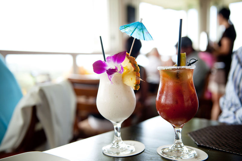 Close-up of cocktails served on table at restaurant