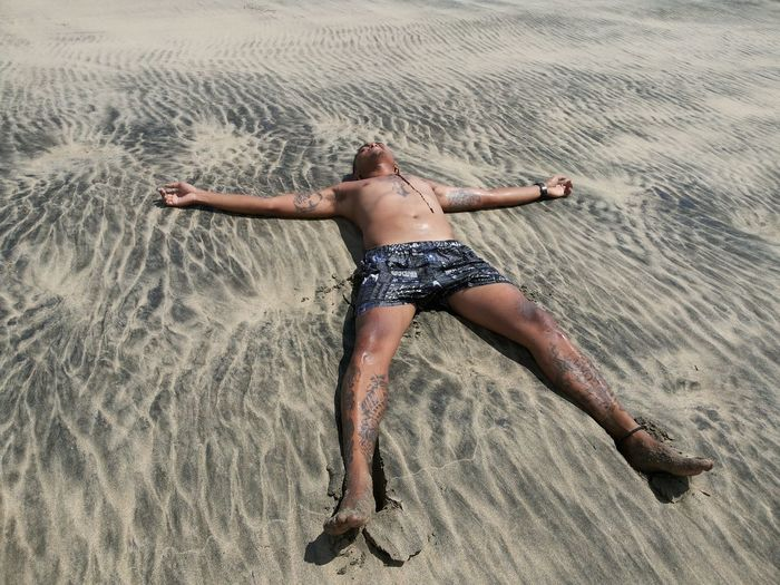 Full length of man on sand at beach