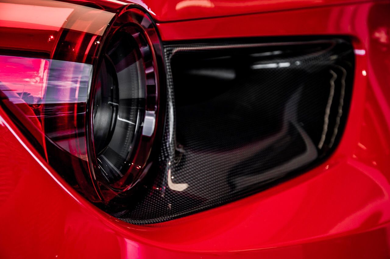 red, car, transportation, mode of transport, sports car, land vehicle, reflection, no people, collector's car, modern, close-up, tire, outdoors, day