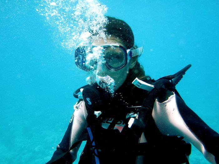 Portrait of mature woman scuba diving in sea