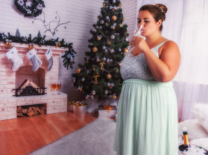 Woman on christmas tree at home