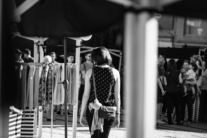 At the fashion market Adult Arts Culture And Entertainment Day Fashion Horizontal Market Marketplace Monochrome Photography One Person Outdoors People Person Rear View