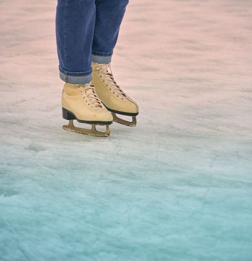 Low section of man ice skating