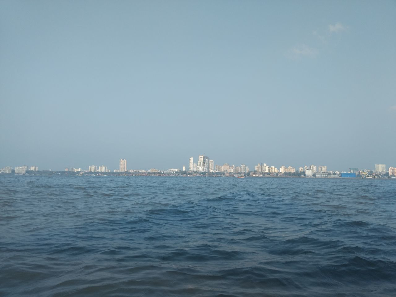 cityscape, city, skyscraper, architecture, sea, clear sky, water, building exterior, no people, modern, urban skyline, outdoors, residential, sky, nature, day