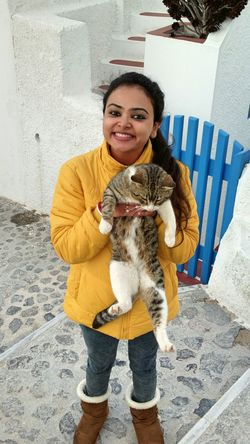 || Street Journals || Santorini, Greece. TheFoneFanatic Nokia  Nokia808 Vacations Feline Cat Animal Love Warm Clothing Young Women Portrait Smiling Happiness Cheerful Front View Pets Looking At Camera Fur Posing Stray Animal