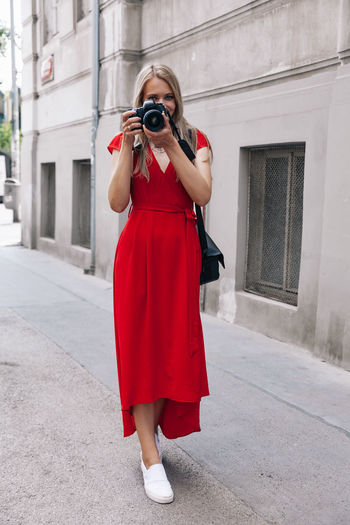 Full length of woman photographing