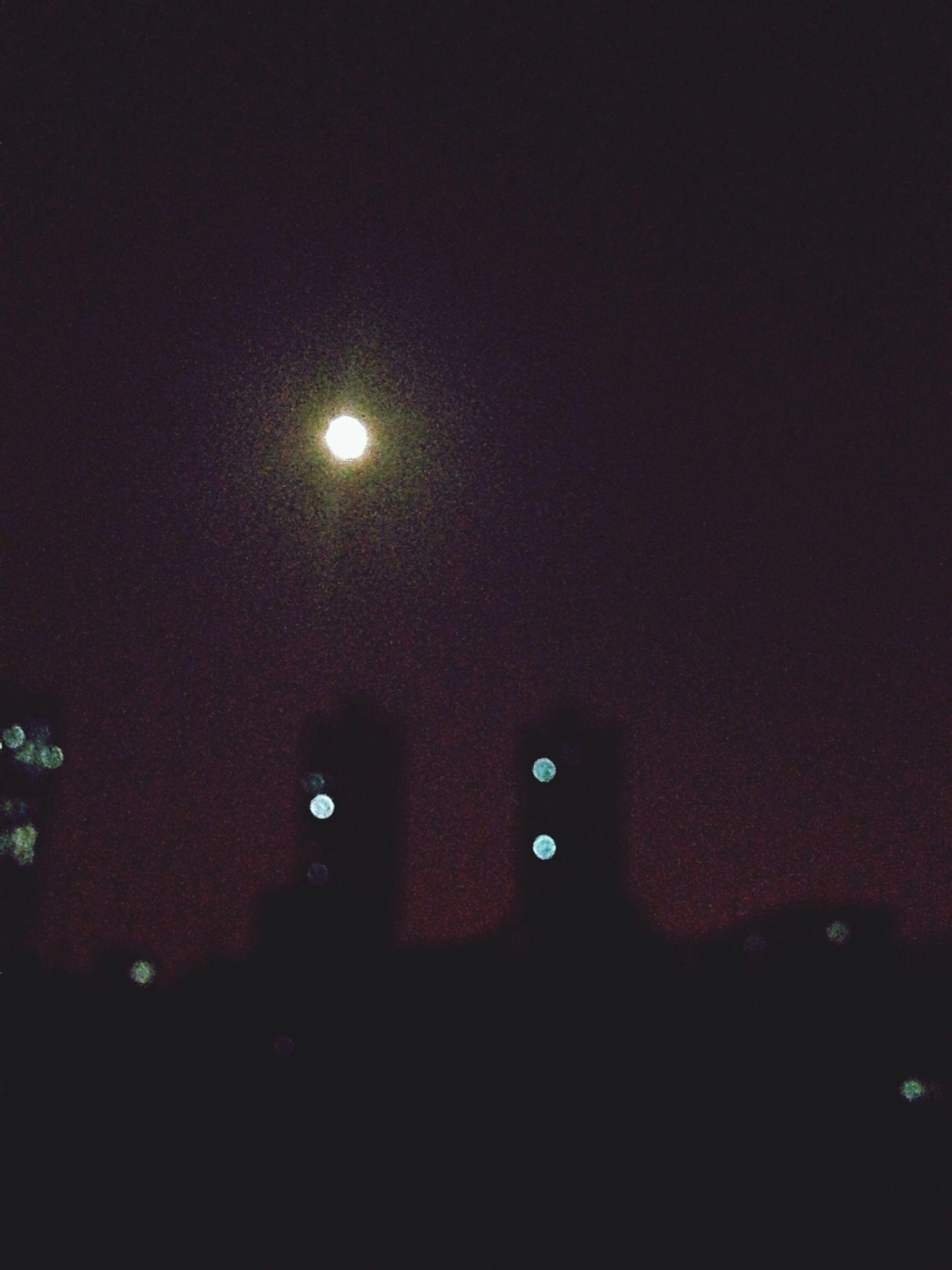 night, illuminated, lighting equipment, dark, moon, glowing, light - natural phenomenon, circle, low angle view, indoors, astronomy, defocused, sky, no people, full moon, light, street light, copy space, electric light