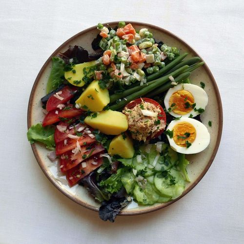 High Angle View Of Vegetable Platter With Tuna Stuffed Tomato And Boiled Egg