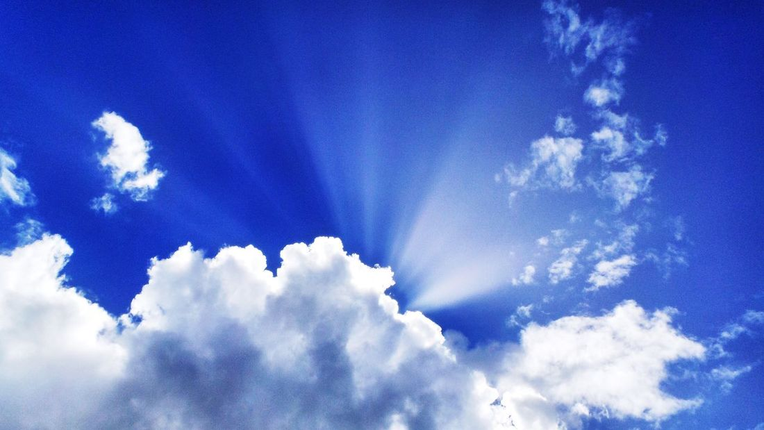 Sky Blue Cloud - Sky Nature Low Angle View Tranquility Fluffy Beauty In Nature Sunbeam Heaven Cloudscape Sunlight Cumulus Cloud Idyllic Tranquil Scene Scenics No People Day Backgrounds Outdoors