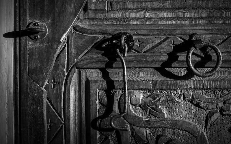 Close-up of old wooden door at night