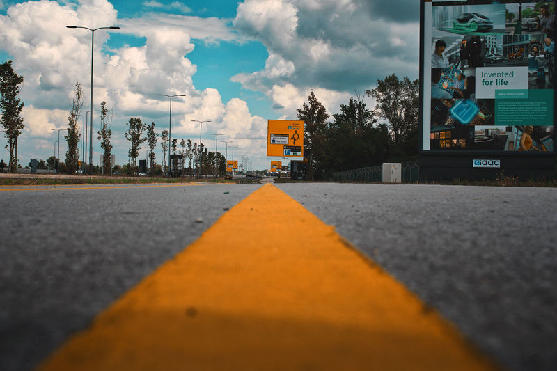 Follow the road Highway LINE Follow The Line Moving EyeEmNewHere City Road Sky Architecture Cloud - Sky Building Exterior Built Structure Empty Road Road Marking Yellow Line White Line Double Yellow Line Asphalt Country Road Roadways The Way Forward Road Sign