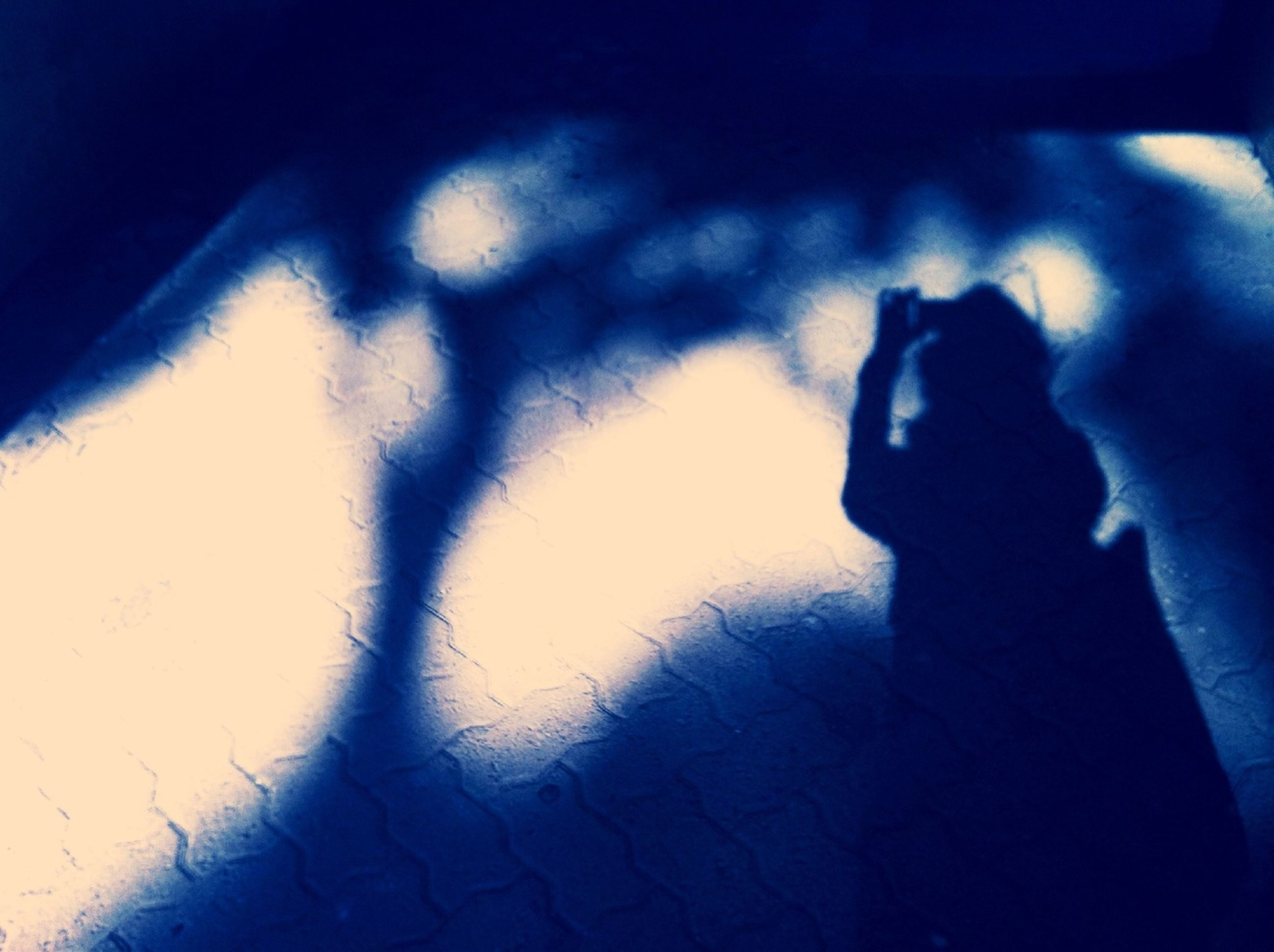 shadow, silhouette, indoors, sunlight, focus on shadow, unrecognizable person, wall - building feature, dark, lifestyles, high angle view, outline, men, part of, day, leisure activity, low section, home interior, close-up