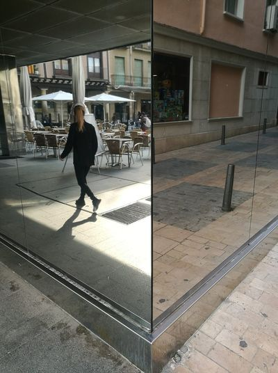 Lostgirl Mirror Reflection One Person Walking Building Exterior Architecture Inspiration Is Every Where HuaweiP9 Reuscity Shooting Photos Streetphotography Inspiration Travel Destinations Tarragona Centregaudi