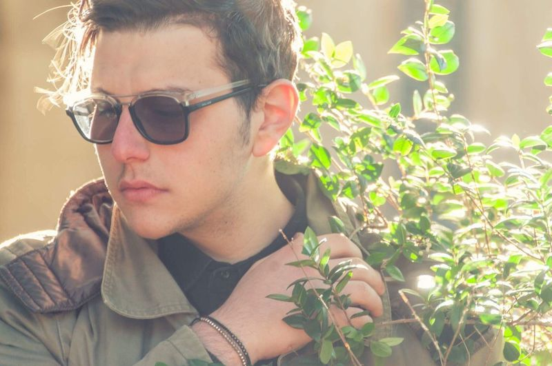 Into the wild Growth Plant Real People Headshot Casual Clothing One Person Sunglasses Portrait Young Adult Lifestyles Nature Eyeglasses  Close-up Day Outdoors People Adult